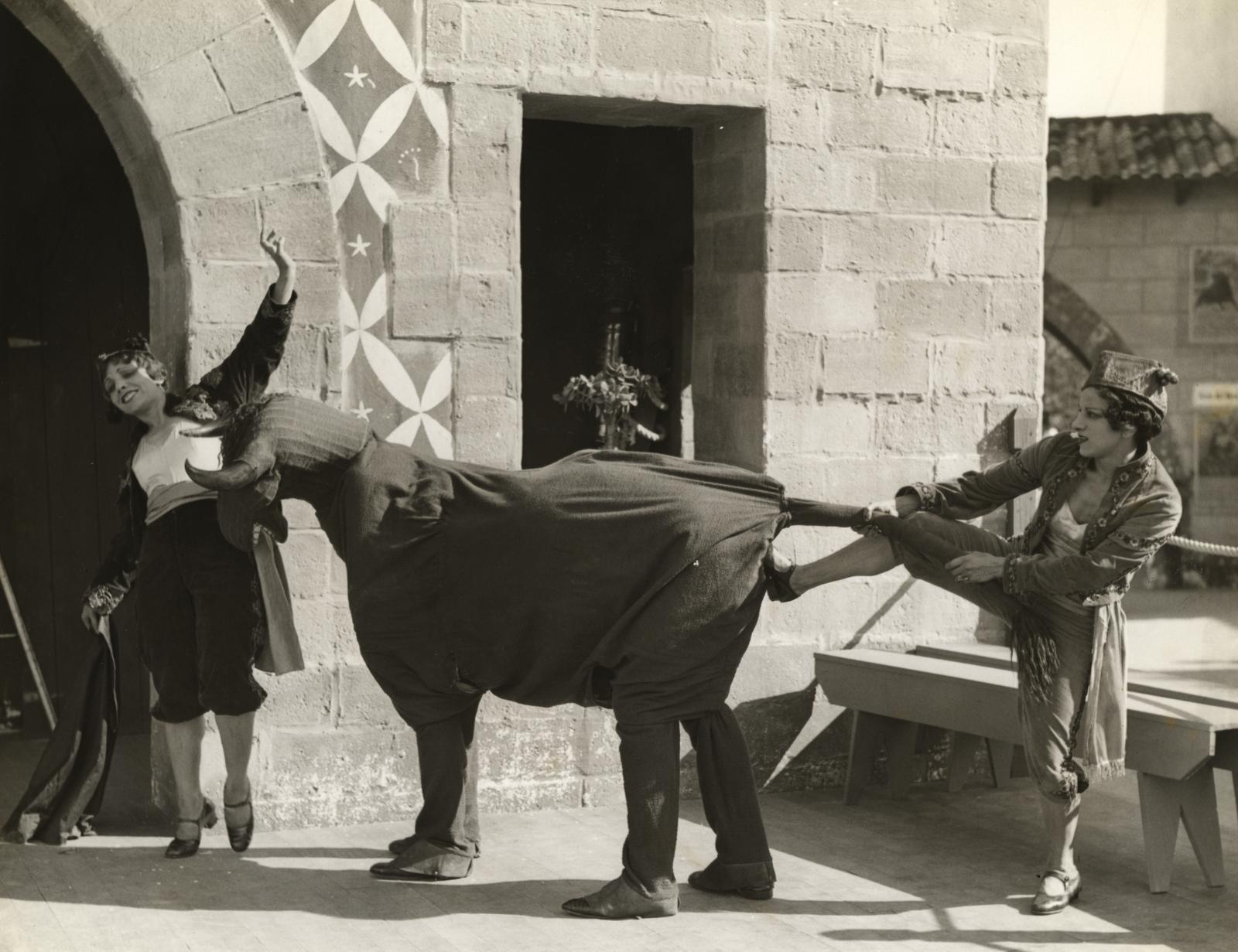[A bullfighting demonstration, with two female matadors and two men inside a bull costume, at the Century of Progress Spanish Village.]