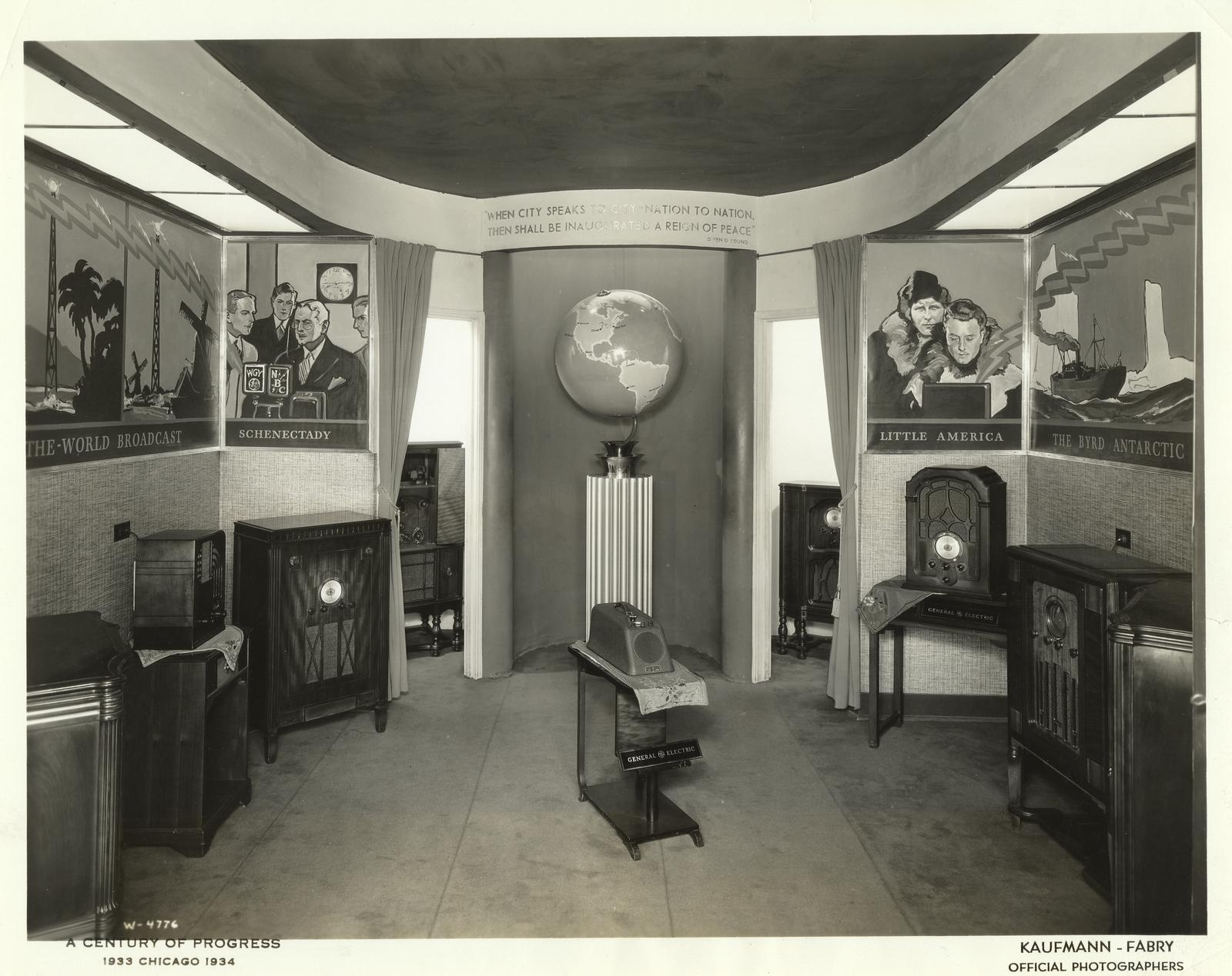 """This display of radio sets, with a background symbolizing radio around the world, in the General Electric exhibit, is attracting much attention at the Century of Progress."""