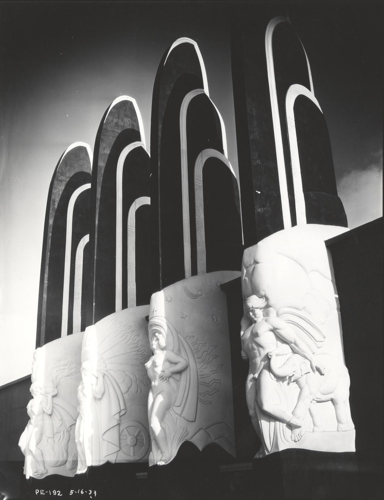 [Four pylon sculptures decorate the north side of the Century of Progress Hall of Social Science.]