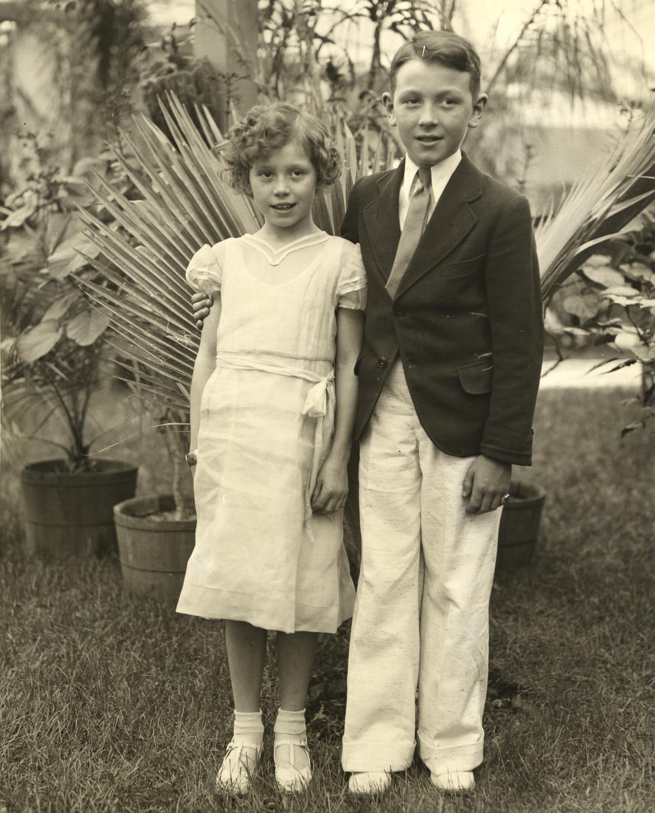 """Barbara Lou and Lawrence Jeffers, of Jacksonville, Fla., the 'Sunshine Twins' of radio fame, looked in on the exhibit of their native state when they visited the Worlds Fair."""