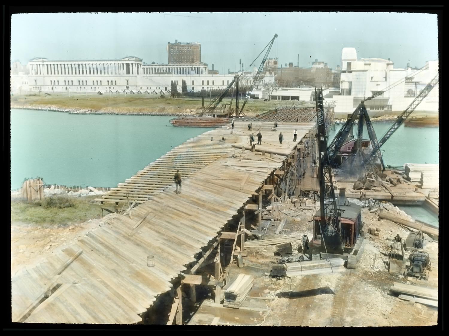 [Artistic depiction of a bridge being constructed across the lagoon in preparation for the Century of Progress.]