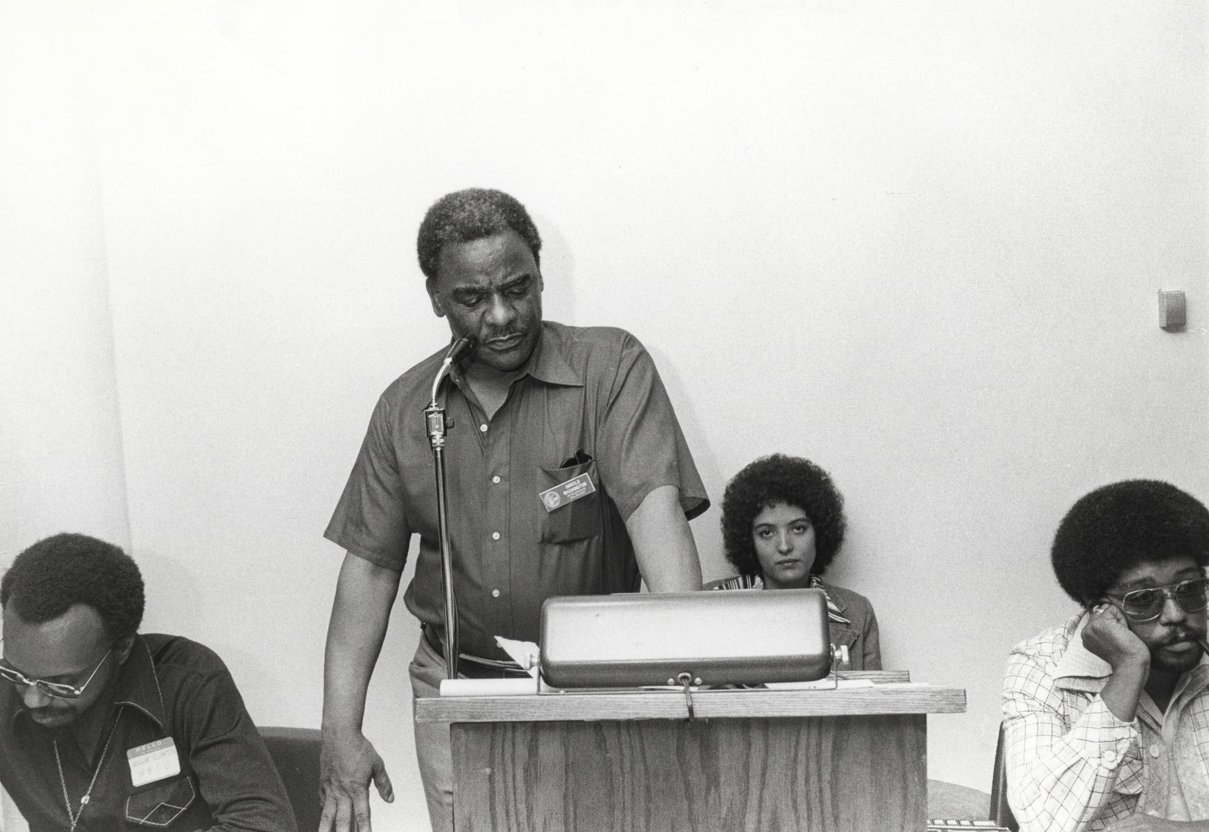Harold Washington and others at a housing conference
