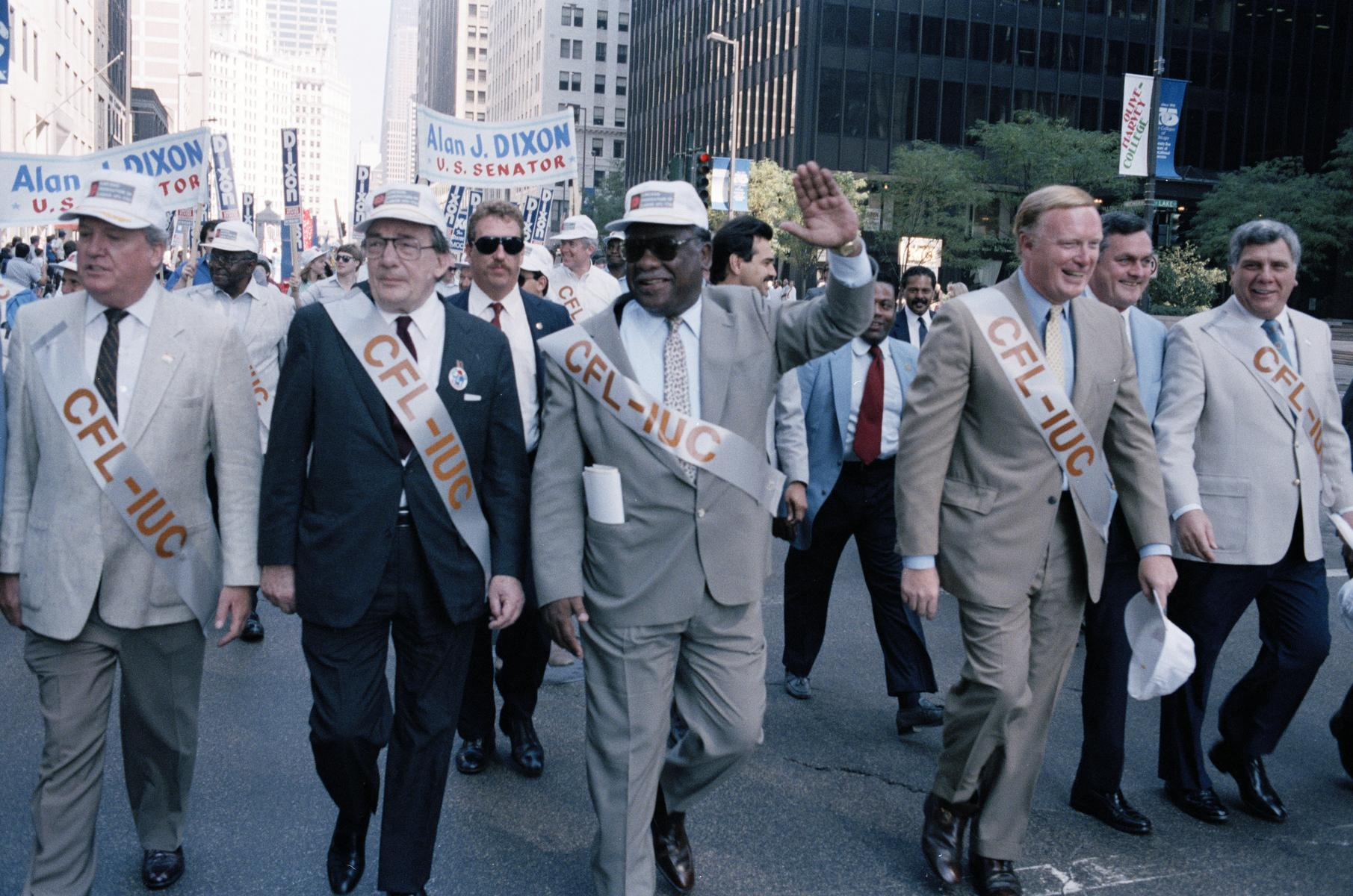 Mayor Harold Washington marches in a Union Parade
